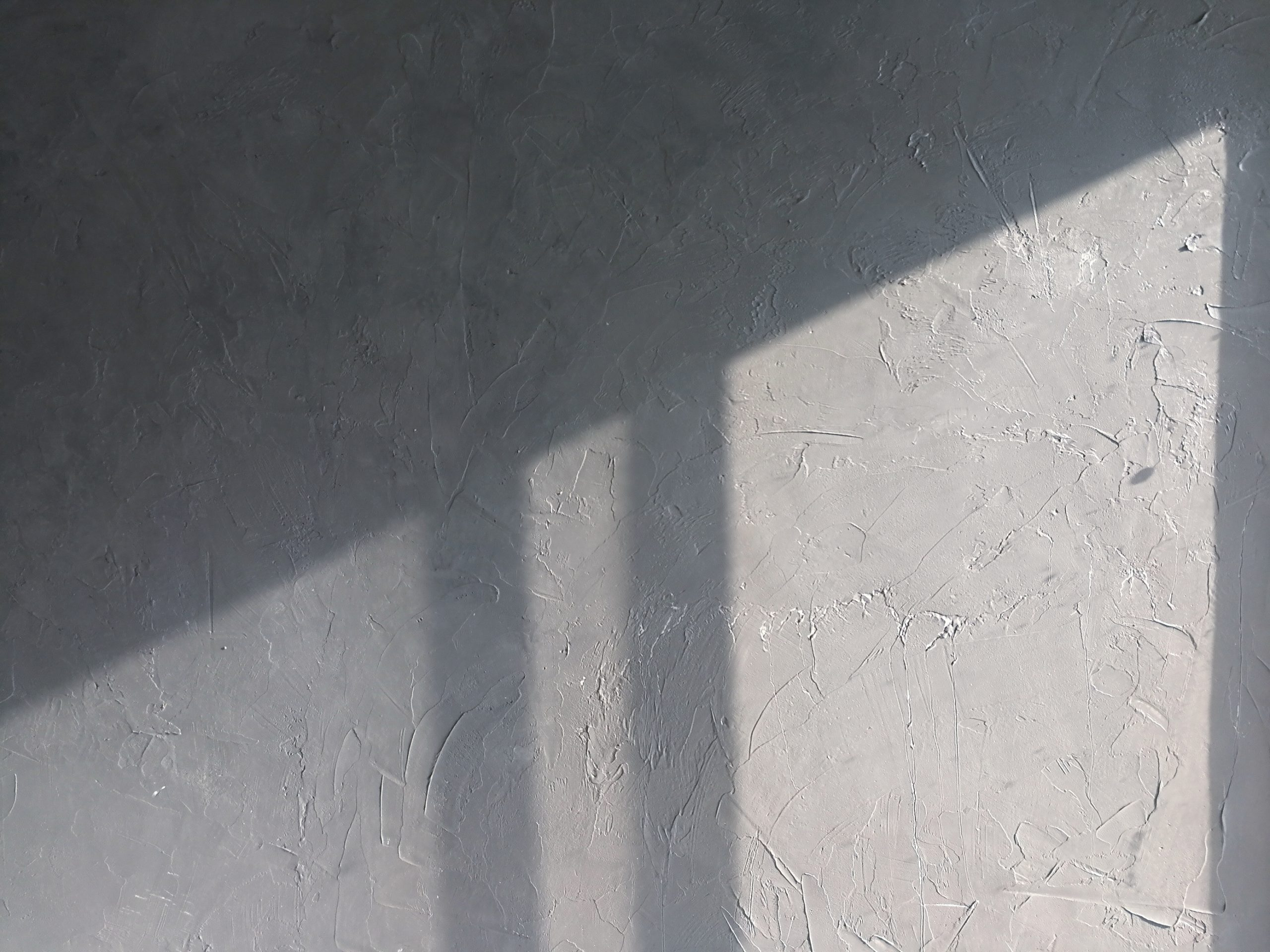 Light and shadow cast on cement wall